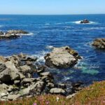 Carmel Breathtaking Shore blue waters crashing into rock formations